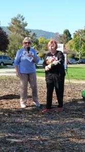 MFPA President, Linda Wilson presents flowers to Sandy Fontona