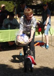 Owner Gail Haywood receives a basket of goodies