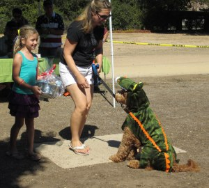 The Alison Wacter family accept Alligator Dog's prize