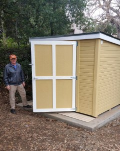 Rich Grialou stands next to the shed